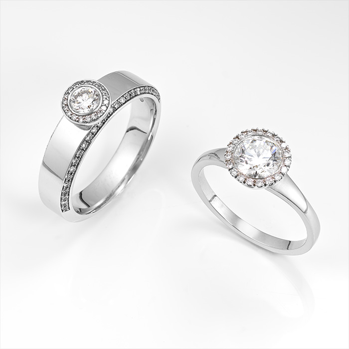 Diamond rings on a white background