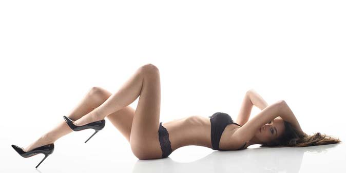 Model laying on studio floor
