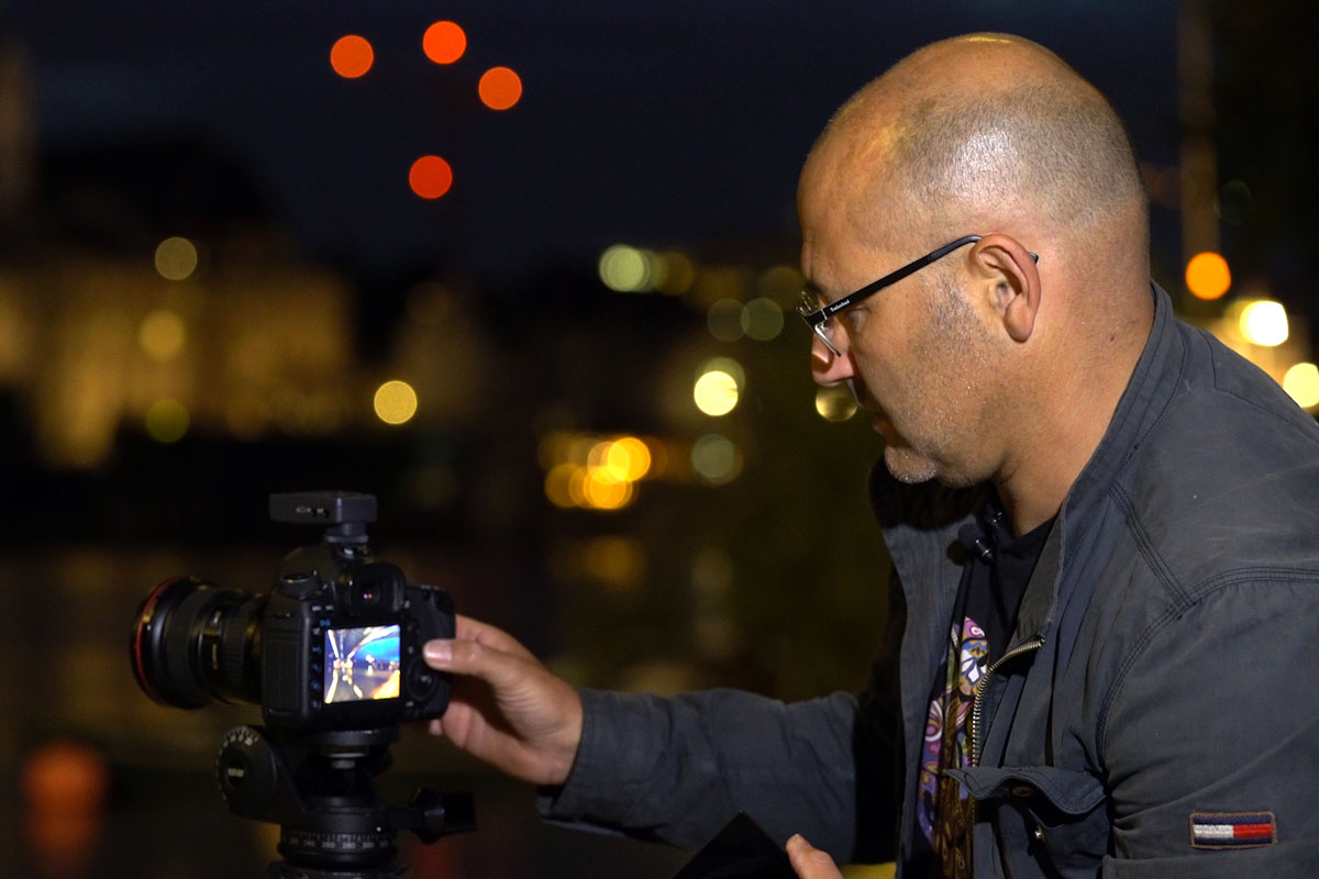 Capturing a professional image at night. Karl Taylor showing camera LCD display.
