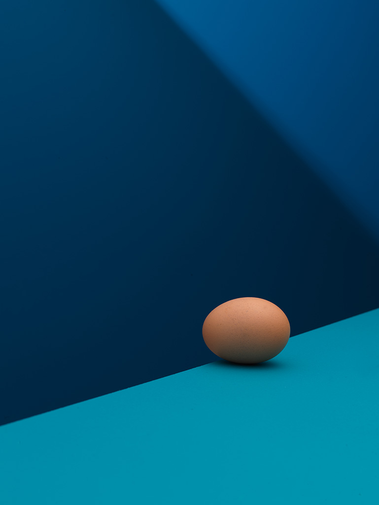 Creative still life photography of an egg. Captured in a small space using minimal camera kit.