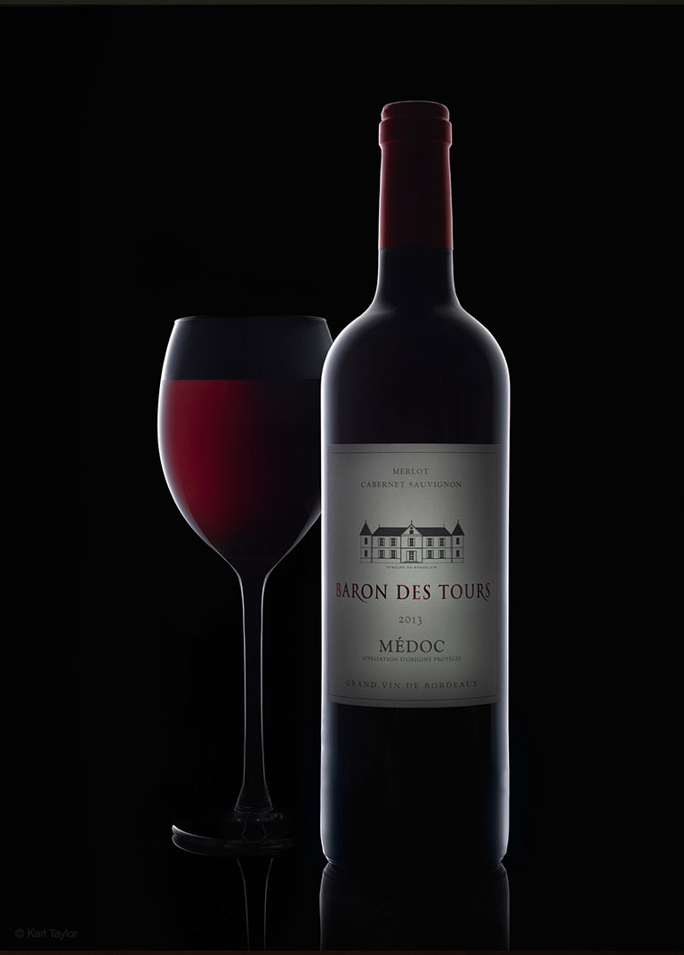 Rim lighting wine bottle photography of glass and Baron Des Tours, 2013, Medoc wine